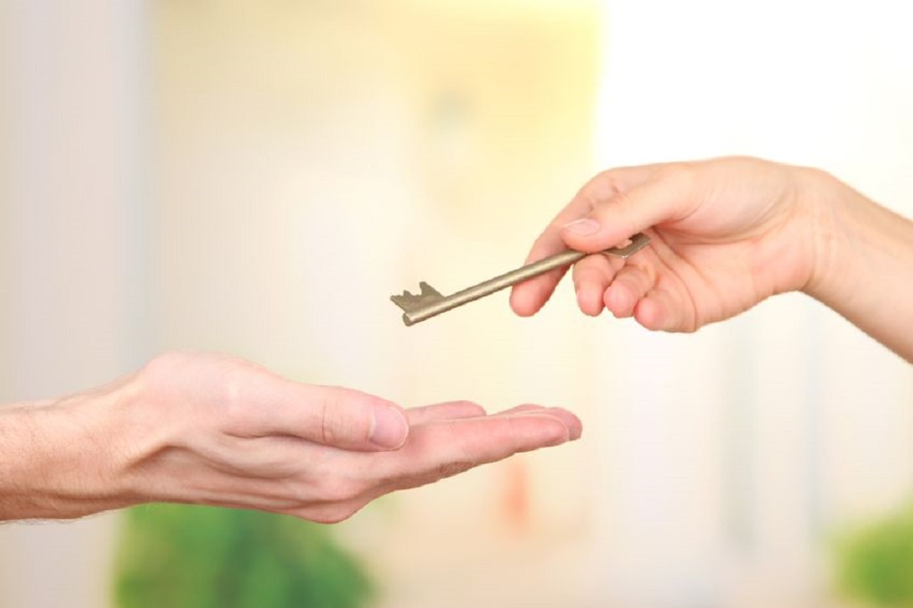 21856152 - transfer of house key, on bright background